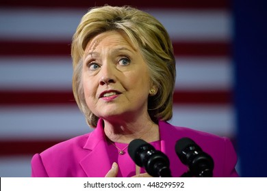 CHARLOTTE, NC, USA - JULY 5, 2016: Hillary Clinton in a magenta suit speaks at a rally at the Charlotte Convention Center in a joint appearance with the US President.