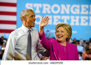 CHARLOTTE, NC, USA - JULY 5, 2016: President Obama and Hillary Clinton take the stage at their first campaign appearance at the Charlotte Convention Center.