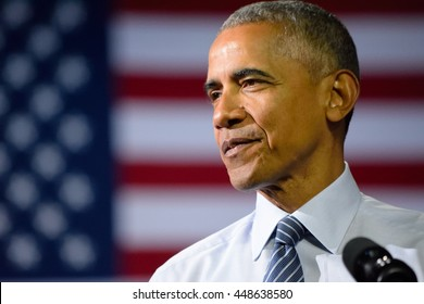 CHARLOTTE, NC, USA - JULY 5, 2016: President Barack Obama with the US flag in the background as he delivers a speech at a campaign rally for the presumptive democratic nominee in Charlotte.