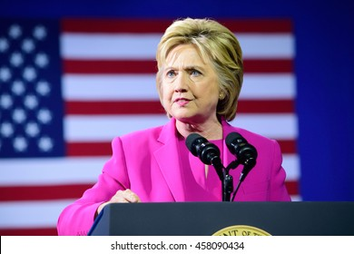 CHARLOTTE, NC, USA - JULY 5, 2016: Hillary Clinton speaks at a campaign rally at the Charlotte Convention Center in a joint appearance with the US President. The American Flag is in her background.