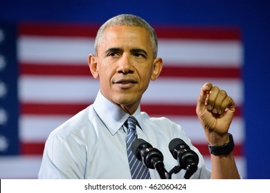CHARLOTTE, NC, USA - JULY 5, 2016: President Barack Obama with the US flag in the background delivers a speech at a campaign rally for the Hillary Clinton at the Charlotte Convention Center.
