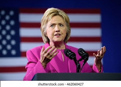CHARLOTTE, NC, USA - JULY 5, 2016: Hillary Clinton with both hands raised gestures as she delivers a speech at a campaign event with US president Barack Obama.