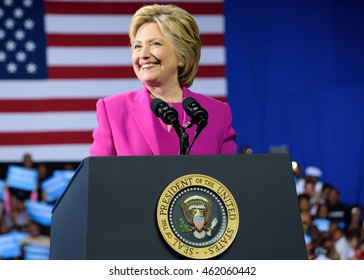 CHARLOTTE, NC, USA - JULY 5, 2016: Hillary Clinton speaks from the podium with the presidential seal at a campaign event with the US president.