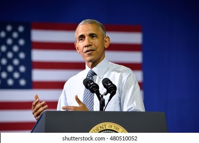 CHARLOTTE, NC, USA - JULY 5, 2016: President Barack Obama gestures at a campaign rally for the presumptive democratic nominee at the Charlotte Convention Center.