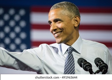 CHARLOTTE, NC, USA - JULY 5, 2016: Barack Obama President of the United States gestures an extended arm toward the crowd during a speech at the Charlotte Convention Center with Hillary Clinton.