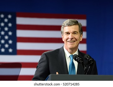 CHARLOTTE, NC, USA - JULY 5, 2016: Roy Cooper against the American Flag. The Attorney General of North Carolina and candidate for NC Governor speaks at a campaign rally for Hillary Clinton.