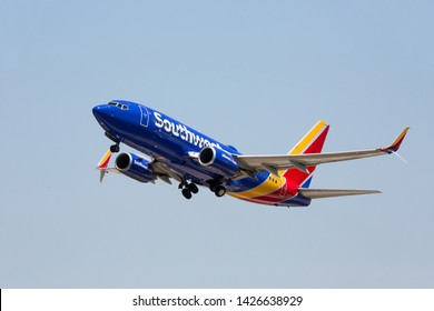 CHARLOTTE, NC (USA) - June 14, 2019: A Southwest Airlines passenger jet retracts its landing gear shortly after taking off from Charlotte-Douglas International Airport.
