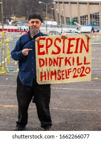 """""""Charlotte, NC / USA - March 2 2020: Man at Trump rally holding a sign that reads Epstein Didn't Kill Himself 2020"""""""
