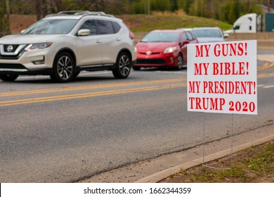 """""""Charlotte, NC / USA - March 2 2020: White sign on the side of the road that reads """"My Guns! My Bible! My President! Trump 2020"""" in red letters"""""""