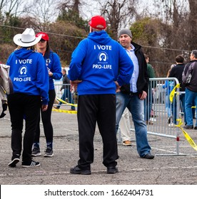"""""""Charlotte, NC / USA - March 2 2020: Man and woman wearing blue hoodies that read """"I Vote Pro Life"""" at the 2020 Trump Rally in Charlotte, NC"""""""