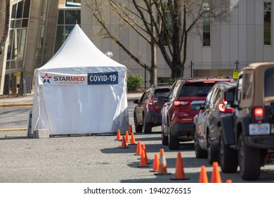 Charlotte, NC USA - March 20,  2021: The waiting line to receive the covid--19 vaccination from Starmed healthcare outside Bojangles Coliseum. Starmed vaccinates hundreds of people everyday.