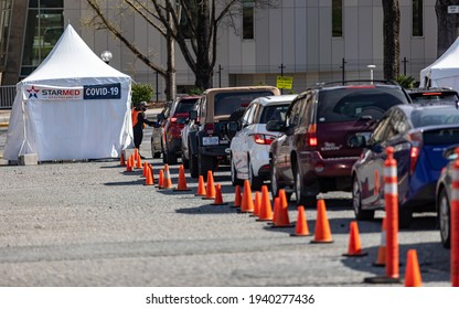 Charlotte, NC USA - March 20,  2021: The waiting line to receive the covid--19 vaccinaation from Starmed healthcare outside Bojangles Coliseum. Starmed vaccinates hundreds of people everyday.