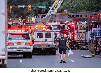 Charlotte, NC / USA - September 30 2019: Charlotte Fire Department vehicles flood the street in response to a fire at a downtown restaurant down the street from the Epicentre in Charlotte, NC