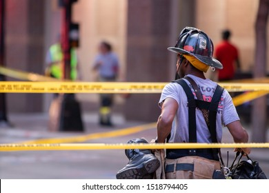Charlotte, NC / USA - September 30 2019: Firefighter from the Charlotte Fire Department responding to a fire in a restaurant located on N College St in downtown Charlotte