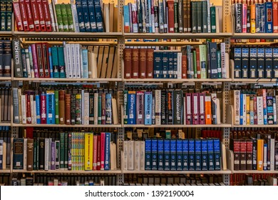 Charlotte, NC/USA - April 26, 2019:  Rows of colorful hardcover library art reference books stacked on shelving in the old main branch library building in uptown Charlotte, NC.  Personal development.