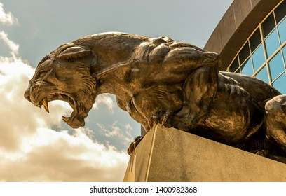 Charlotte, NC/USA - May 10, 2019: Medium closeup of statue of one of two fierce crouching panthers adorning sides of the entrances of Bank of America football stadium. Symbol of  Carolina Panthers.
