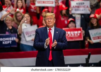 Charlotte, North Carolina - 2 March 2020: President Trump clapping upon entering the rally in the Bojangle's Coliseum