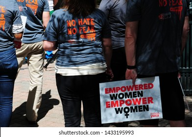 Charlotte, North Carolina / USA - June 14, 2019: Empowered Women, Empower Women. Eliminating Racism, Empowering Women. YWCA protest sign. The Square, Uptown Charlotte at Trade and Tryon Streets.