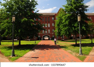 Charlotte, North Carolina / USA - June 20, 2019: A student walks towards Lynch Residence Hall on the campus of UNCC, the University of North Carolina at Charlotte.
