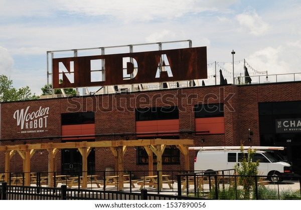 Charlotte, North Carolina / USA - June 20, 2019: NODA sign, the acronym for North Davidson Street, at the 36th Street light rail train station in a gentrified neighborhood north of Uptown Charlotte.