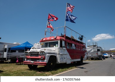 Charlotte, North Carolina / USA - May 20th 2017: A NASCAR fans RV parked in the infield at Charlotte Motor Speedway. Confederate Flag and Trump flags flying high