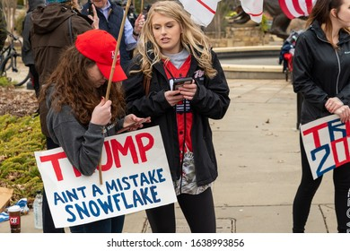 CHARLOTTE, NORTH CAROLINA/USA - February 7, 2020: Young female supporters of President Donald Trump await his arrival in Charlotte, North Carolna on February 7, 2020