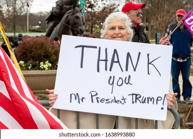 CHARLOTTE, NORTH CAROLINA/USA - February 7, 2020: Woman holds a sign of support for President Donald Trump during his visit to Charlotte, North Carolina on February 7, 2020