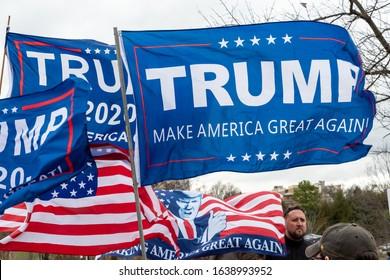 CHARLOTTE, NORTH CAROLINA/USA - February 7, 2020: Trump flags fliy in the stiff wind awaiting Presdient Donald Trump's visit to Charlotte, North Carolina on February 7, 2020