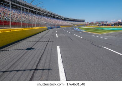 Charlotte, North Carollina/USA - May 20th 2017: Looking down Charlotte Motor Speedway from the start of corner one, the track and stands are empty ready for a full days racing in the sun