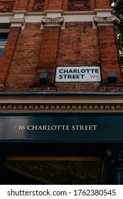 Charlotte street name on the building with W1 postcode on it. Charlotte Street is a street in Fitzrovia, central London. Named in honour of Queen Charlotte