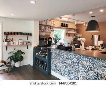 Charlotte, USA - June 5, 2019: Undercurrent Coffee serves fresh roasted coffee, good food and homemade bakery. This cozy cafe is a place to sit and relax, meet and discuss, taste and explore.