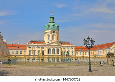 Charlottenburg Palace (Schloss Charlottenburg) behind its fence, Berlin, Germany (Deutschland);  The palace was built at the end of the 17th century and was greatly expanded during the 18th century.