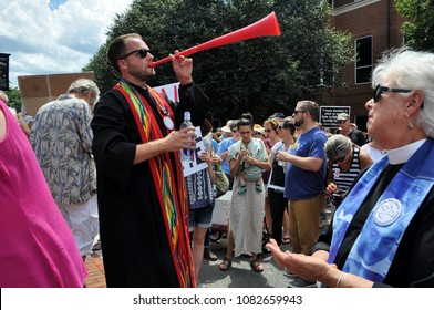 CHARLOTTESVILLE, VA–July 8, 2017: Counter protesters and clergy gather in opposition when members of a North Carolina KKK group arrive to rally in a local park.