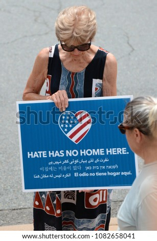 CHARLOTTESVILLE, VA–July 8, 2017: Counter protesters and clergy gather early to prepare, organize and to pray for peace at a local church. Later members of a NC KKK group will rally in a nearby park.