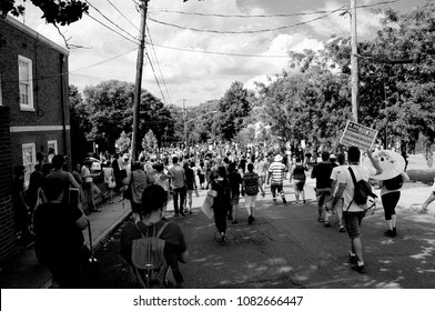 CHARLOTTESVILLE, VA–July 8, 2017: Counter-protesters rush to surround vehicles that carry members of a North Carolina KKK group trying to leave the area. Police call an unlawful assembly to disband th