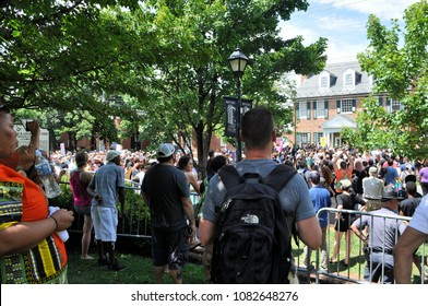 CHARLOTTESVILLE, VA–July 8, 2017: Members of a NC KKK group and a handful of supporters rally around a statue of Stonewall Jackson while a much larger number of counter-protesters gather in opposition