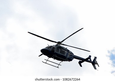 CHARLOTTESVILLE, VA–July 8, 2017: A Police helicopter hovers over the scene where members of a North Carolina KKK group and counter-protesters gather in a local park.
