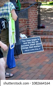 CHARLOTTESVILLE, VA–July 8, 2017: Protest signs in Charlottesville the day members of a North Carolina KKK group arrive to rally in a local park.