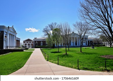 """CHARLOTTESVILLE, VA– April 9, 2020- One person sits on the lawn at University of Virginia. Due to a """"stay-at-home order"""" in response to the COVID-19 pandemic, university Grounds are virtually empty."""