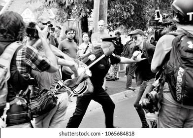 A Charlottesville City Police Officer steps between protesters during the rally on August 12, 2017 in Charlottesville, Virginia.