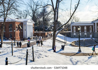 Charlottesville, USA - January 24, 2013: Students of the Univeristy of Virginia walk to and from class on campus grounds during winter snow