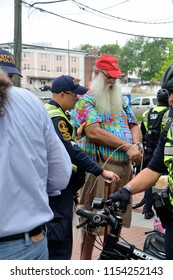 CHARLOTTESVILLE, VA – Aug 11, 2018: A man is arrested in Charlottesville after purchasing razors which were among the city's prohibited items on the first anniversary of a rally that killed 3 in 2017.