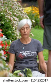 CHARLOTTESVILLE, VA – Aug 11, 2018: A woman meditates in hopes for a peaceful weekend on the one-year anniversary of a rally that turned violent in Charlottesville, Virginia.