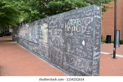CHARLOTTESVILLE, VA – Aug 11, 2018: Chalked messages on a wall in the downtown area of Charlottesville on the one-year anniversary of a rally that turned violent.