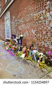 CHARLOTTESVILLE, VA – Aug 11, 2018: Flowers are left at the site where Heather Heyer was killed on the one-year anniversary of a rally that turned violent.