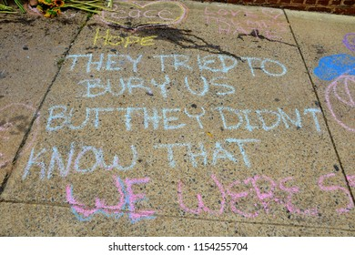 CHARLOTTESVILLE, VA – Aug 11, 2018: Chalked messages at the site where Heather Heyer was killed on the one-year anniversary of a rally that turned violent.
