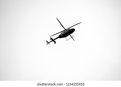 CHARLOTTESVILLE, VA – Aug 11, 2018: A police helicopter hovers over the downtown area of Charlottesville on the one anniversary of a rally that turned violent.