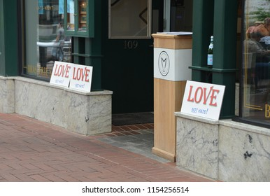 CHARLOTTESVILLE, VA – Aug 11, 2018: Posters in solidarity are posted at local business in Charlottesville on the one-year anniversary of a rally that turned violent.