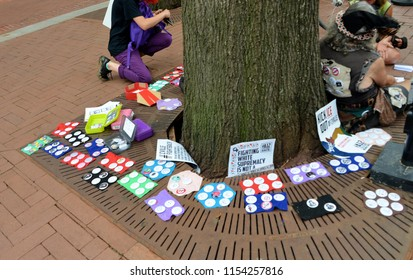 CHARLOTTESVILLE, VA – Aug 11, 2018: Locals sell buttons in Charlottesville on the one-year anniversary of a rally that turned violent in Charlottesville, Virginia.