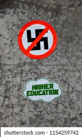 CHARLOTTESVILLE, VA – Aug 11, 2018: Stickers in the Downtown area of Charlottesville on the one anniversary of a rally that turned violent.